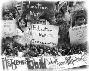 Photos of children holding signs at the May 8 rally, with slogans like 'Save our Schools' and 'Education Not Incarceration'