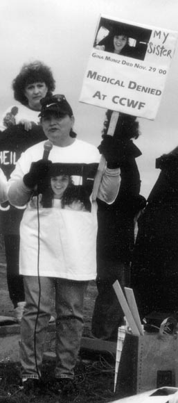 Grace Ortega speaks about her daughter, Gina Muniz, at a rally outside the prisons in Chowchilla, California