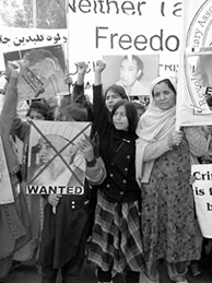 Afghan women demonstrating at a Revolutionary Association of the Women of Afghanistan (RAWA) rally
