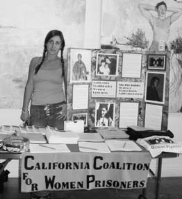 Sole A. at a CCWP table at Oakland Hip Hop Film Festival in July featuring The Fire Inside and a display made by CCWP volunteers